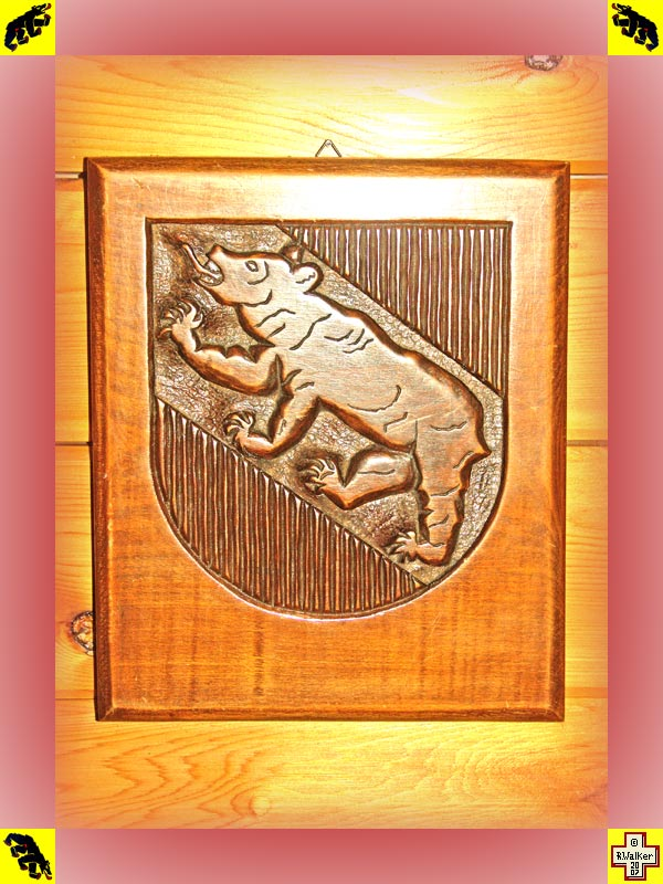 Photo: Bern Bear on carved wooden plaque.